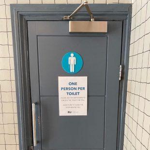 Ku-Bar toilet signage