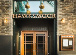 Exterior of Hawksmoor, Borough, featuring the double-doors and menu
