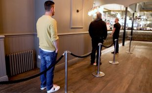 Socially distanced queuing at Stonegate pub