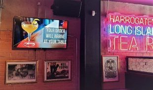 Interior of Mojo Bar showing signage that drinks will be brought to tables