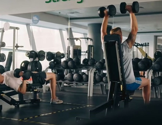Gym goers doing bench presses at Surrey Sports Park