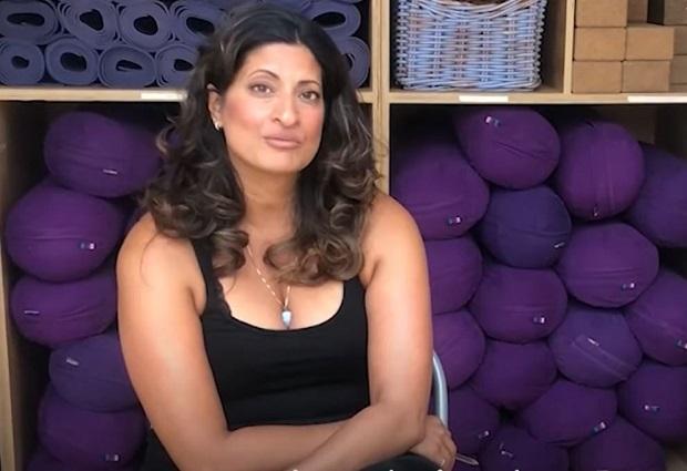Raakhee Thompson of Triyoga inside a studio with yoga equipment