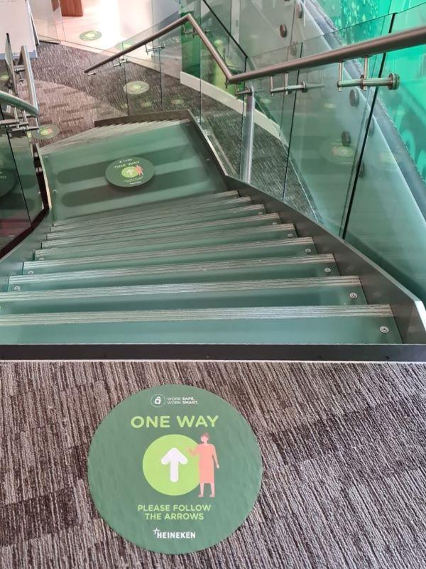 Heineken stairwell with directional stickers