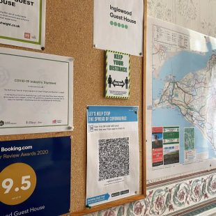 Noticeboard featuring NHS Test and Trace QR Code at Inglewood guesthouse