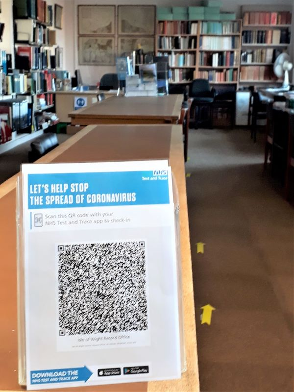NHS Test and Trace QR Code on counter at Isle of Wight Heritage Services